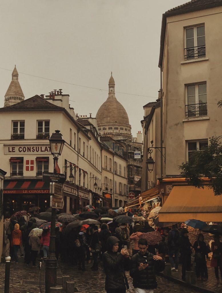 Tourists crowding the winding lanes around Sacre Coeur