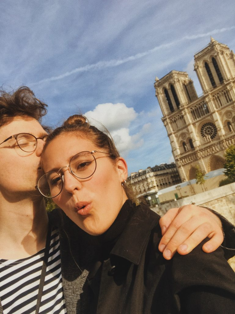 Kissing in front of Notre Dame