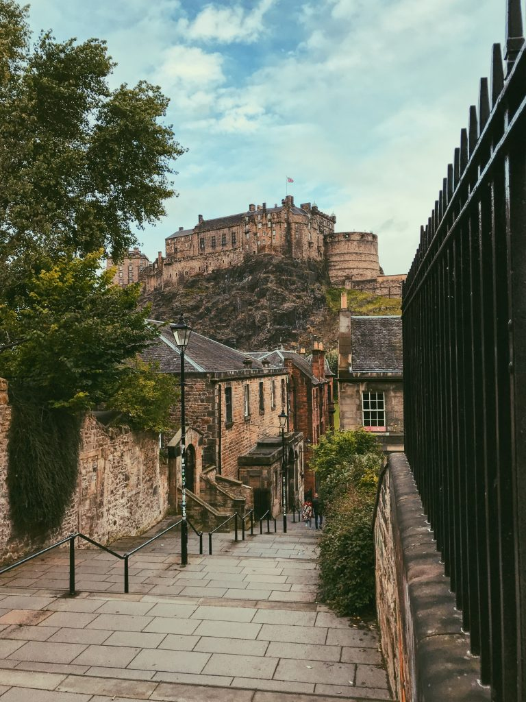 Edinburgh Castle in the background of The Vennel pathway