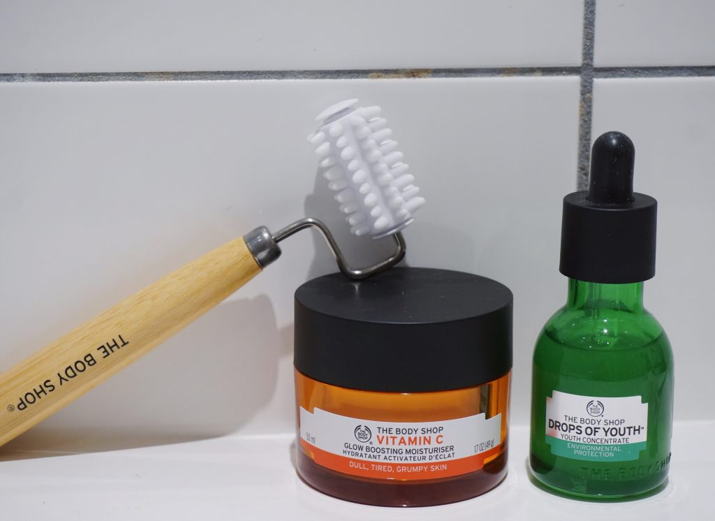 the body shop skincare routine - vitamin c cream, facial stimulator, drops of youth serum