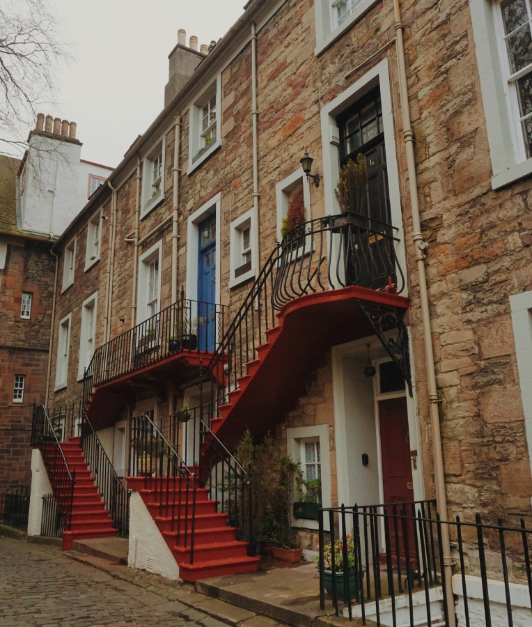 Buildings in Edinburgh with external red staircase